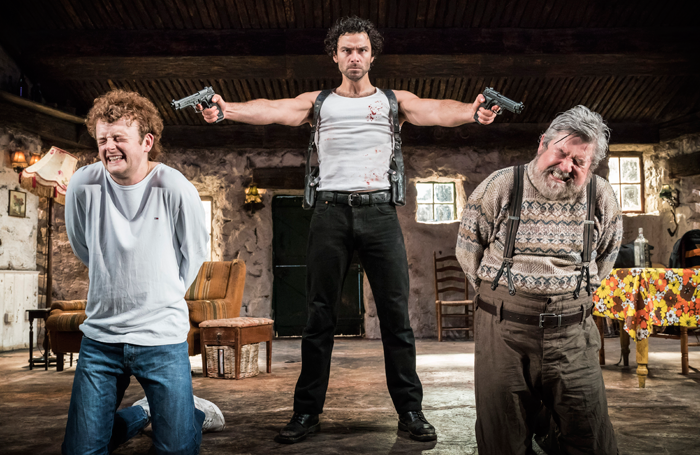 Chris Walley, Aidan Turner and Denis Conway in The Lieutenant of Inishmore. Photo: Johan Persson