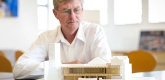 Malvern Theatres' chief executive Nic Lloyd with the architect's model of the proposed new workshop space. Photo: James Watkins