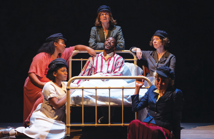 Clockwise around the bed from left: Aretha Ayeh, Sophia Nomvete, Clare Burt, Amanda Hadingue and Sandy Foster all as Joan Littlewood, and centre Solomon Israel as Gerry Raffles. Photo: Topher McGrillis