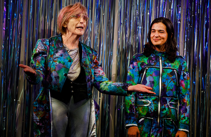 Kate Bornstein and Ty Defoe as the Persons in Charge in Straight White Men. Photo: Joan Marcus