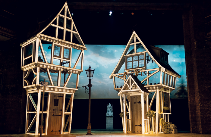 The set for The Merry Wives of Windsor (above), featuring LED-illuminated, timber-framed houses, includes two revolves and a hydraulic lift. Photo: Manuel Harla