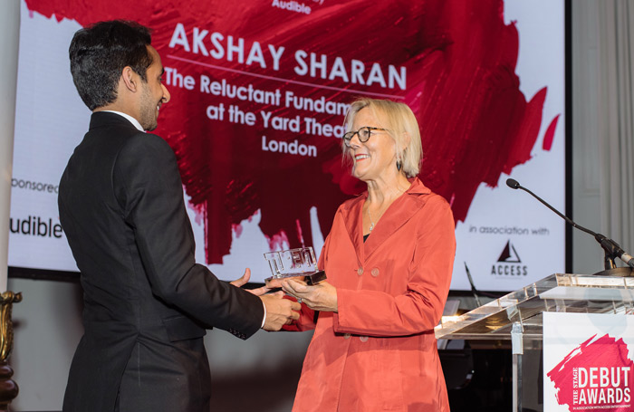 Director Phyllida Lloyd (right) presents Akshay Sharan with The Stage Debute Award for best actor in a play. Photo: David Monteith-Hodge