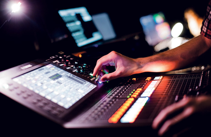 A student operating a digital mixer. Photo: Kirsten McTernan