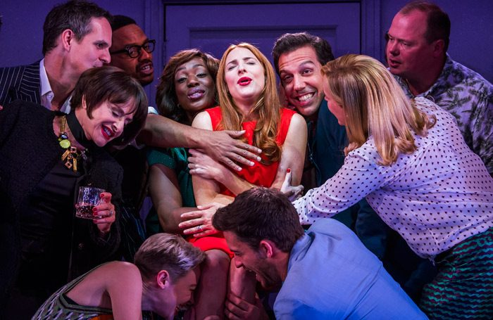Rosalie Craig (centre) and the cast in Company. Photo: Tristram Kenton