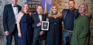 Members of Norwich's acclaimed GoGoHares visual art community project with their Norfolk Arts Award. Photo: Simon Finlay