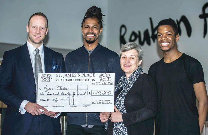 AAG Wealth Management's Oliver Tunnicliffe presents a cheque to Lyric's Nicholai La Barrie and Sian Alexander, and Start graduate and Young Lyric member Wesley Bozonga. Photo: Chris Payne