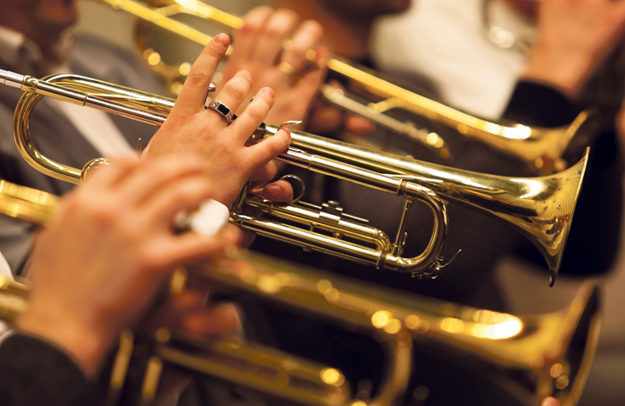 When musicians were moved around during the rehearsal, the viola players sat directly in front of the trumpet section. Photo: Shutterstock