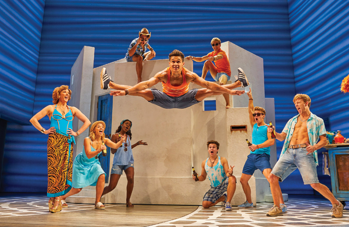 Damian Buhagiar as Pepper, centre, with the cast of Mamma Mia! at the Novello Theatre, London. Photo: Brinkhoff Mögenburg