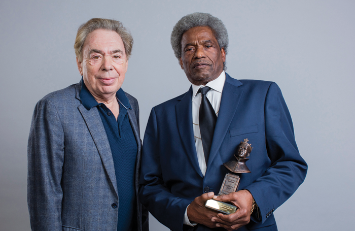 Linford Hudson receiving the special recognition Olivier from Andrew Lloyd Webber. Photo: David Levene