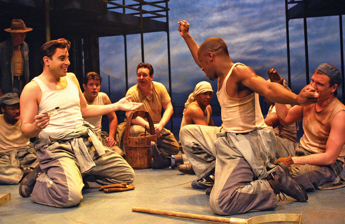 Giles Terera and cast in Jailhouse Rock in 2004, which won rave reviews. Photo: Tristram Kenton