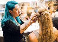 Hair and make-up working backstage on Troilus and Cressida in 2018