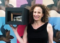 Artistic director Maria Striar wth a model box for Plano