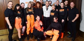 Robbie Williams and the LMA Choir. Photo: Ian West