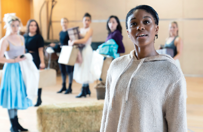 Amara Okereke and members of the ensemble in rehearsals for Oklahoma! Photo: Johan Persson